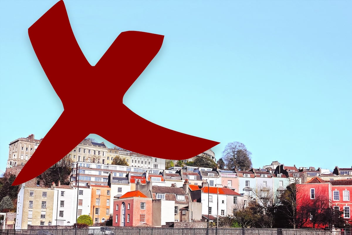 A picture of a hill on which is built residential housing. A large cross represents sales that have fallen through.