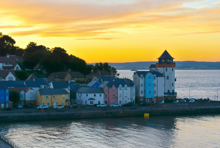 Sunset over the Fisherman's Village in Portishead. Colourful residential buildings along a waterfront.