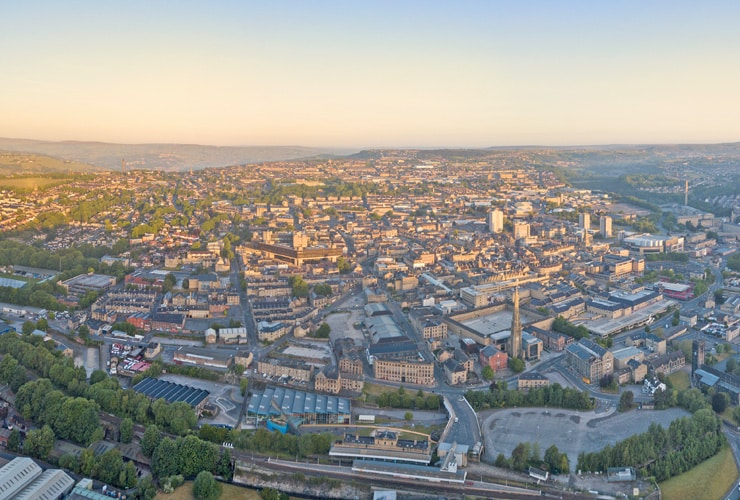 Aerial view of a sunlit Halifax in the early morning, Calderdale, West Yorkshire, UK.