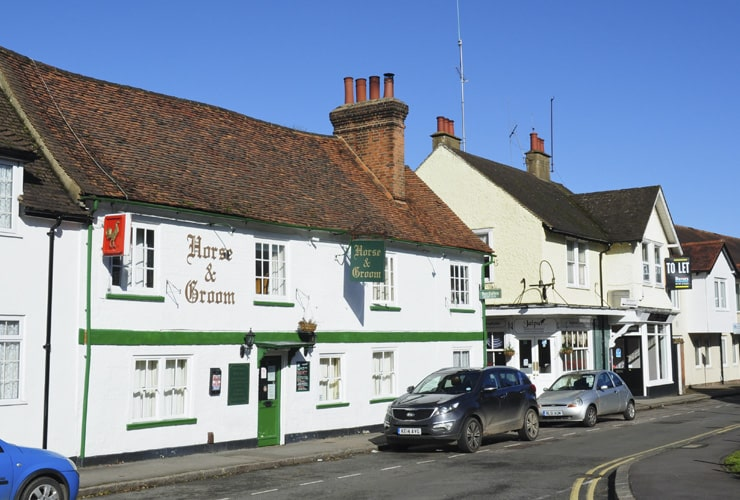 An old, white-painted pub on Park Street in Old Hatfield on a bright summer day.