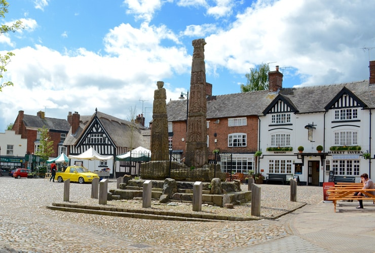 A memorial with a pub in the background. The market town of Sandbach in the county of Cheshire.