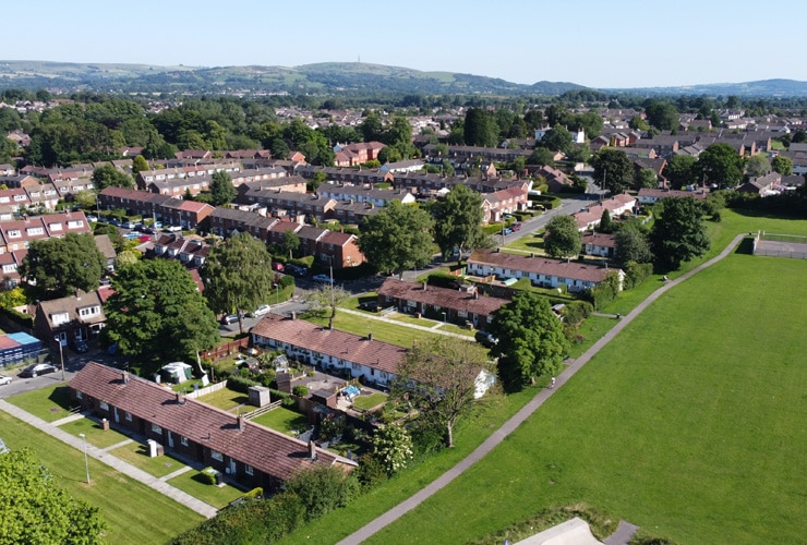 An aerial view of a housing estate next to a park. Photograph of the Western Estate in Macclesfield.