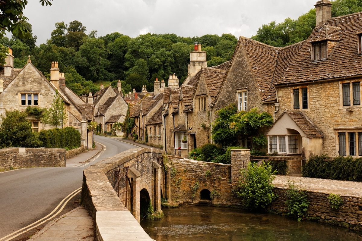 A rustic, old-world English village. The high street in Castle Combe, Wiltshire.
