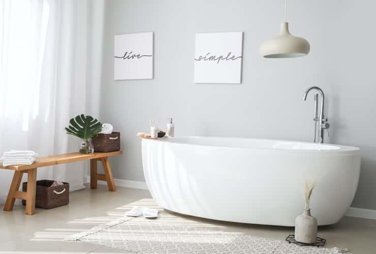 A slippler bath in a stylish, modern bathroom.