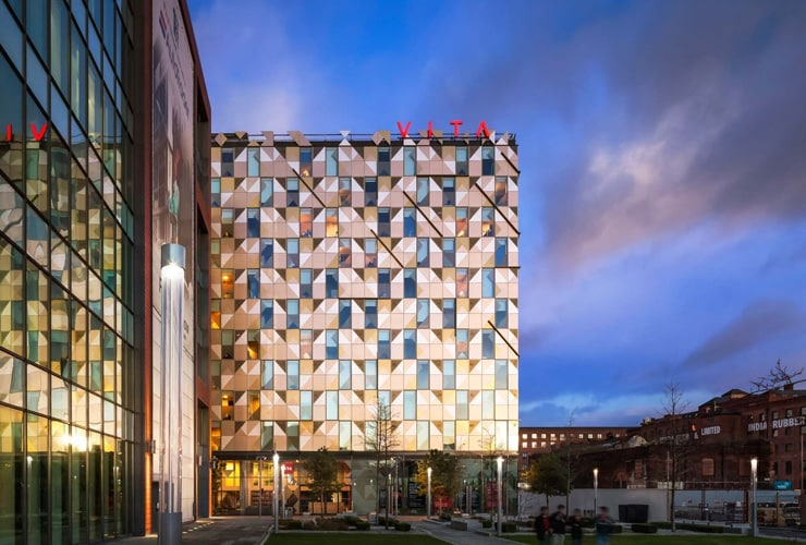 The outside of the Vita Student project at dusk. Photograph taken on First Street, Manchester.