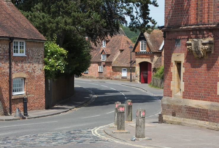 Architecture in the historic and beautiful Beaulieu village in the New Forest area of Hampshire, England, UK, showing ancient brick and timber houses with a herringbone pattern.
