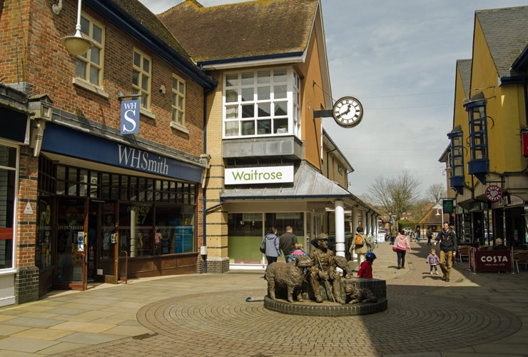 Shoppers walking on a pedestrianised road in town centre of Petersfield.