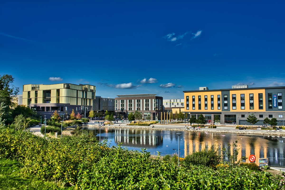 Commercial buildings round a small lake in Telford town centre.