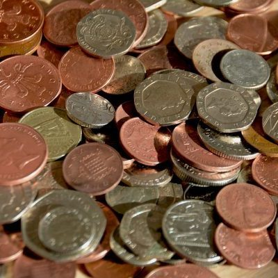 Pile of Coins. UK Currency. Property Investments UK. Contingency Budget. Buy to let landlord tip. Property investor tip