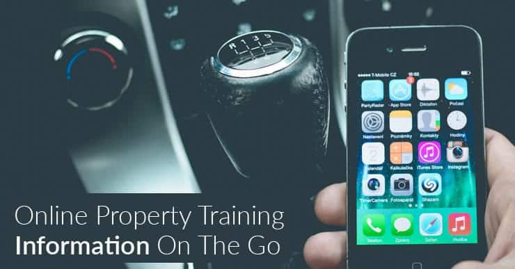 An iPhone being used in the driver's seat of a car. Online property training. Information on the go